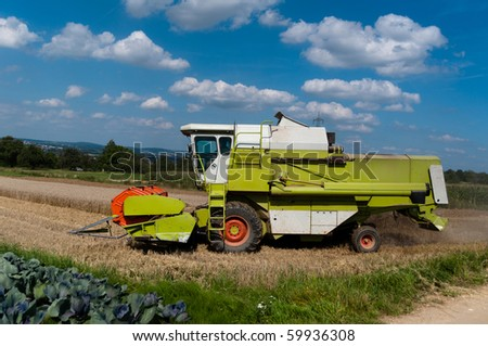 combine harvesting corn on a german field the corn stays. Black Bedroom Furniture Sets. Home Design Ideas