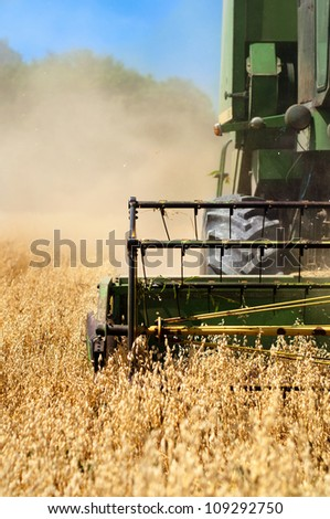Combine harvesting machinery collecting wheat from the fields