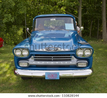 COMBINED LOCKS, WI - AUGUST 18:  Front view of a blue 1958 Chevy Apache classic truck at the 2nd Annual Horizon of Hope Generations Car and Truck Show on August 18, 2012 in Combined Locks, Wisconsin.