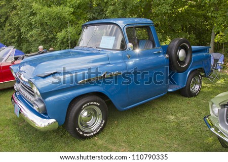 COMBINED LOCKS, WI - AUGUST 18:  Side view of a blue 1958 Chevy Apache classic truck at the 2nd Annual Horizon of Hope Generations Car and Truck Show on August 18, 2012 in Combined Locks, Wisconsin.