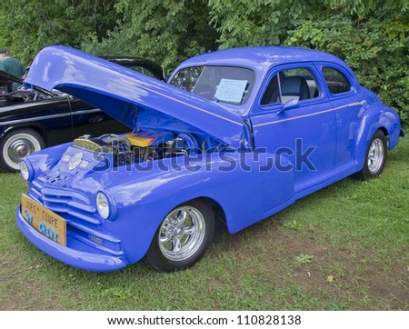 COMBINED LOCKS, WI - AUGUST 18: Side view of a blue 1947 Chevy two door Coupe classic car at 2nd Annual Horizon of Hope Generations Car and Truck Show on August 18, 2012 in Combined Locks, Wisconsin.