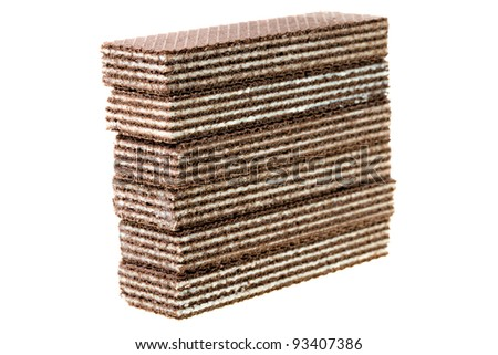 Combined one on another chocolate wafers. It is isolated on a white background. Small depth of sharpness
