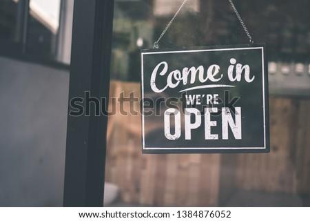 Come in we're open, vintage black retro sign