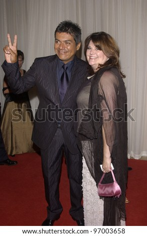 Comedian GEORGE LOPEZ & wife at Noche de Ninos event at the Beverly Hills Hilton to benefit Childrens Hospital Los Angeles. October 2, 2004