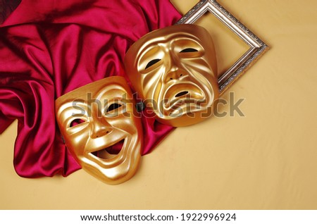 Comedy and tragedy masks with purple drapery. Stock fotó ©
