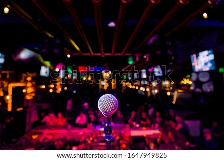 Comedy Microphone on Stage of Comedy Music Show in Club with Lights and Colors Stock foto ©