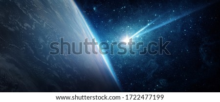 Comet, asteroid, meteorite flying to the planet Earth. Glowing asteroid and tail of a falling comet threatening the safety of the Earth. The concept of the apocalypse, armageddon, doomsday.