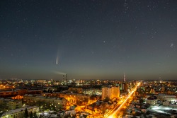 Comet in the sky over the night city