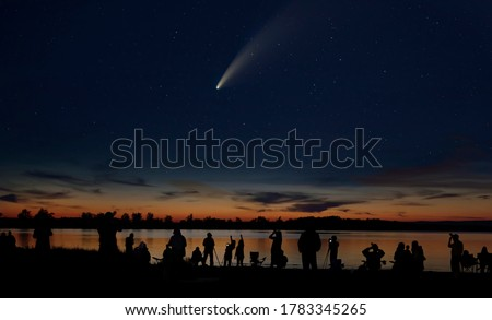 Photo of  Comet Neowise and crowd of people  silhouetted by the Ottawa river admiring and photographing the comet