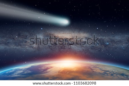 "Comet on the space - Planet Earth in front of the Milky Way galaxy ""Elements of this image furnished by NASA "" #1103682098"