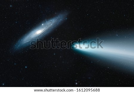 Comet on the space with Andromeda galaxy