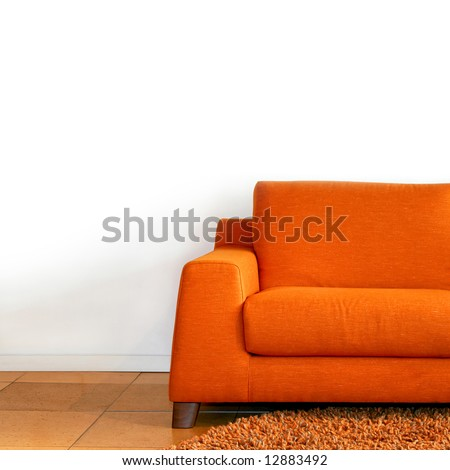 Comfort orange textile sofa in living room