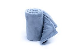 Comfort Rolled up grey coral fleece throw isolated on white background