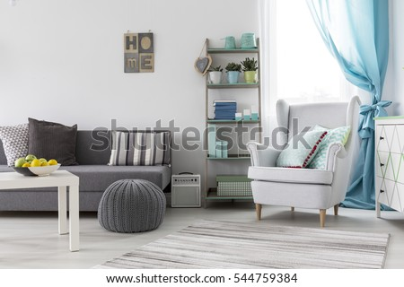 Comfortable and adorable living room with cozy places for rest #544759384