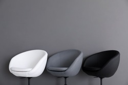 Comfortable armchairs on grey background