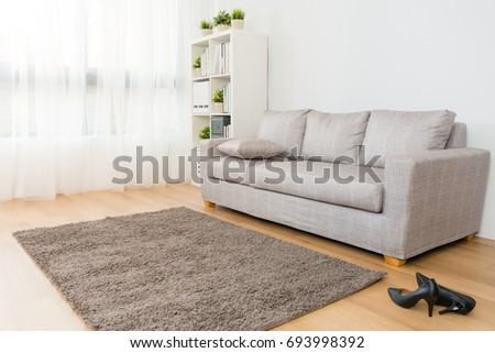 comfortable beautiful living room with business woman high heel shoes.