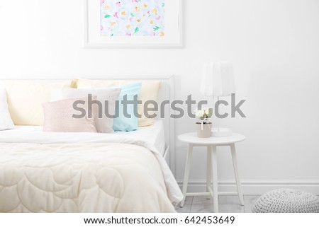 comfortable bed with coverlet...