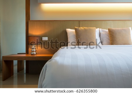 comfortable bed with headboard,Thailand. #626355800