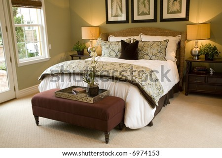 Comfortable bedroom in a luxury home with stylish decor.