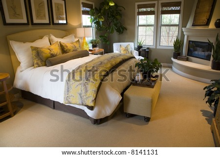 Comfortable bedroom with lounge area and modern fireplace for Master bedroom corner fireplace