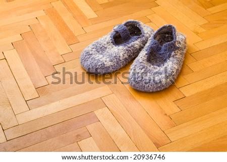 comfortable blue slippers on parquet