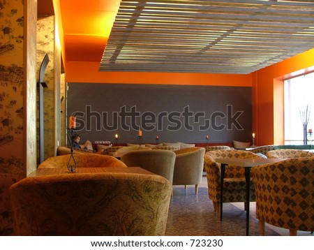 comfortable cafeteria, person reading quietly in the corner