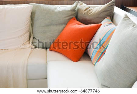 Comfortable corner in family room, with multi-colored pillows.
