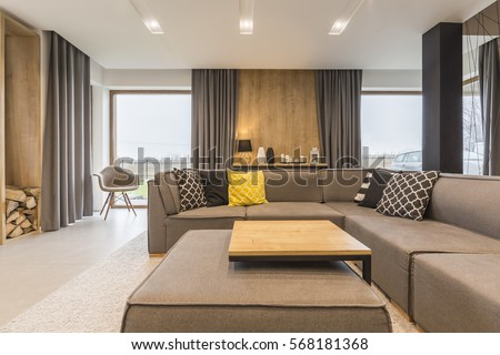 Comfortable couch in living room interior #568181368