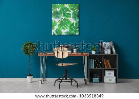 Comfortable home workplace with laptop on desk #1033518349
