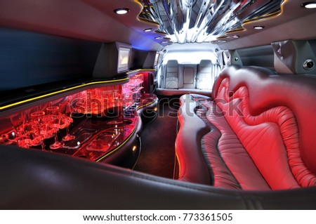 Comfortable interior of sedan car with red colorful lights without people