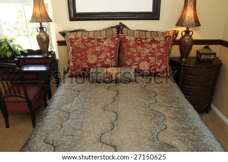 Comfortable modern designer bedroom with stylish furniture and decor.