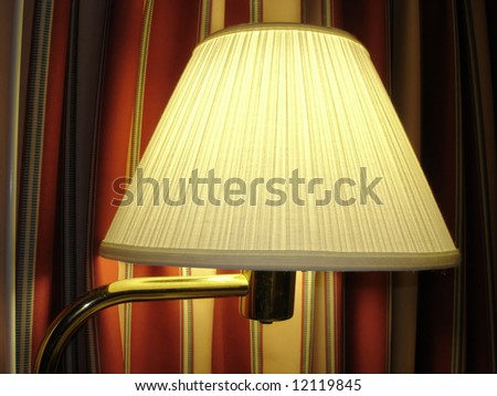 Comfortable Night Lamp against colored curtains; close up