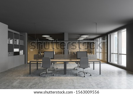Comfortable open space office interior with gray walls, concrete floor, big computer tables, two conference room and bookcases with folders. 3d rendering