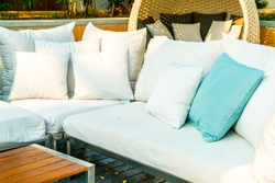 comfortable pillows on outdoor patio chair and table in garden