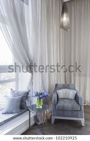 comfortable room corner, leather chair and tea table by the wind