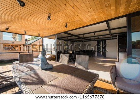 Comfortable seats in modern and luxury interior of log cabin