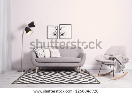 Comfortable sofa with pillows in modern living room interior #1268846920