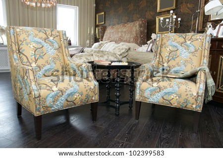 comfortable upholstered chairs and a coffee table