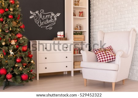 Comfortable white armchair in a living room with christmas decorations
