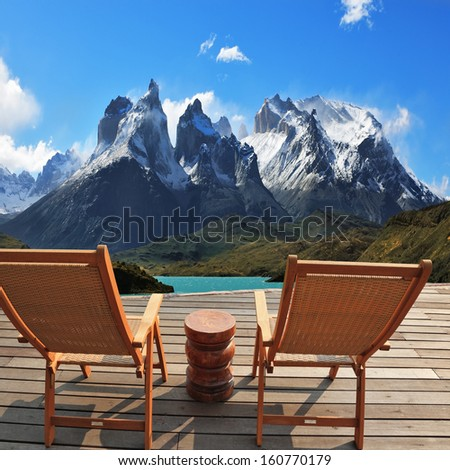 Comfortable wooden chair - chaise lounges stand on a wooden platform. Lookout is arranged in front of the famous cliffs of Los Kuernos. National Park Torres del Paine, Patagonia, Chile. Collage