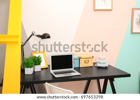 Comfortable workplace in interior of modern room