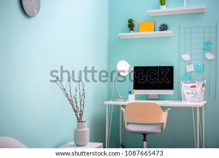 Comfortable workplace with computer on desk in home office #1087665473