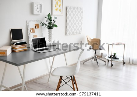 Comfortable workplace with laptop in office