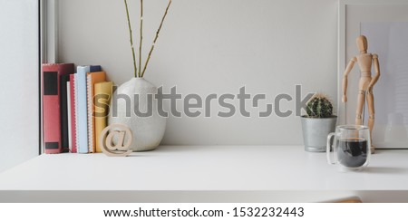 Comfortable workspace with books, office supplies and copy space on white wooden table
