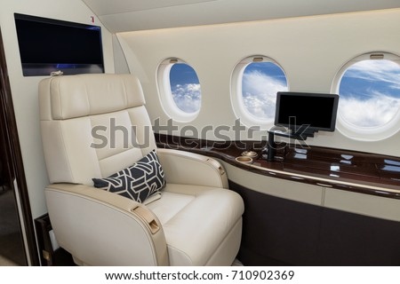 Comfortible cabin chair in a modern business jet during flight. ストックフォト ©
