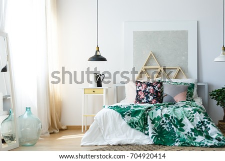 Comfy bedroom with different warm materials, textures and soothing colors