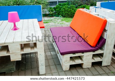 comfy pallet for sitting with a table #447421573