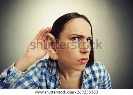 comic picture of serious woman with one big ear listening attentively and looking at camera. photo on dark background