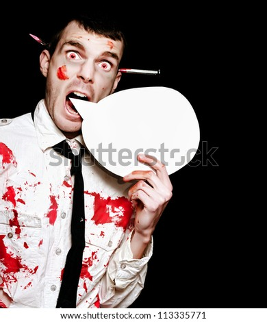 Comical Photo Of A Evil Halloween Zombie Shouting Out A Horror Message Of Blood And Gore Through A Round Speech Bubble On Black Background