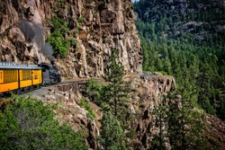 Coming Around the Mountain/The Durango Silverton Narrow Gauge Railroad takes passengers along sheer cliffs and around mountain bends.